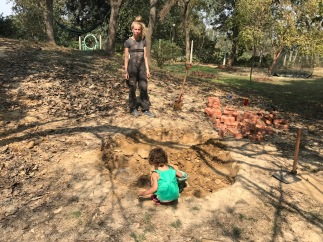 We filled the hole with water to loosen up the soil as it was hard as stone. This mud-party was great for the two-year old Zara.