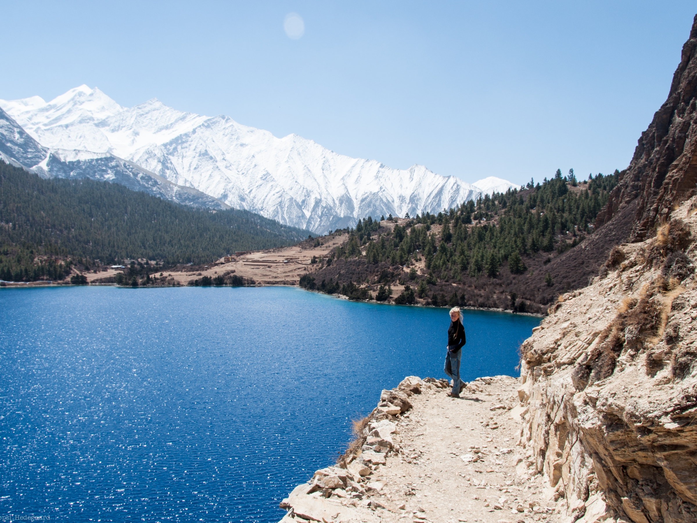 Taking a walk along the clean and cold high-altitude lake Dolpo.